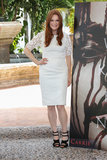 Julianne Moore created a trendy black-and-white pairing in a white lace Dolce & Gabbana dress and black strappy sandals at the Carrie photo call in Cancun.