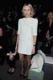 Naomi Watts sat front row at the Louis Vuitton Fall 2013 show in Paris in a mod white dress with cute pocket details, completed with black pumps, a white coat, and a minty Louis Vuitton bag.