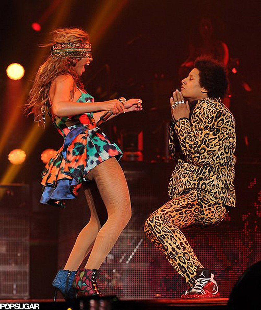 The back of Beyoncé's Kenzo shorts featured a tiered tail. She completed the look with nude fishnet stockings and colorful booties.