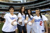 Kim Kardashian, her mom, Kris Jenner, and sisters Kourtney Kardashian and Khloé Kardashian all got in uniform for the LA Dodgers game in May 2009.