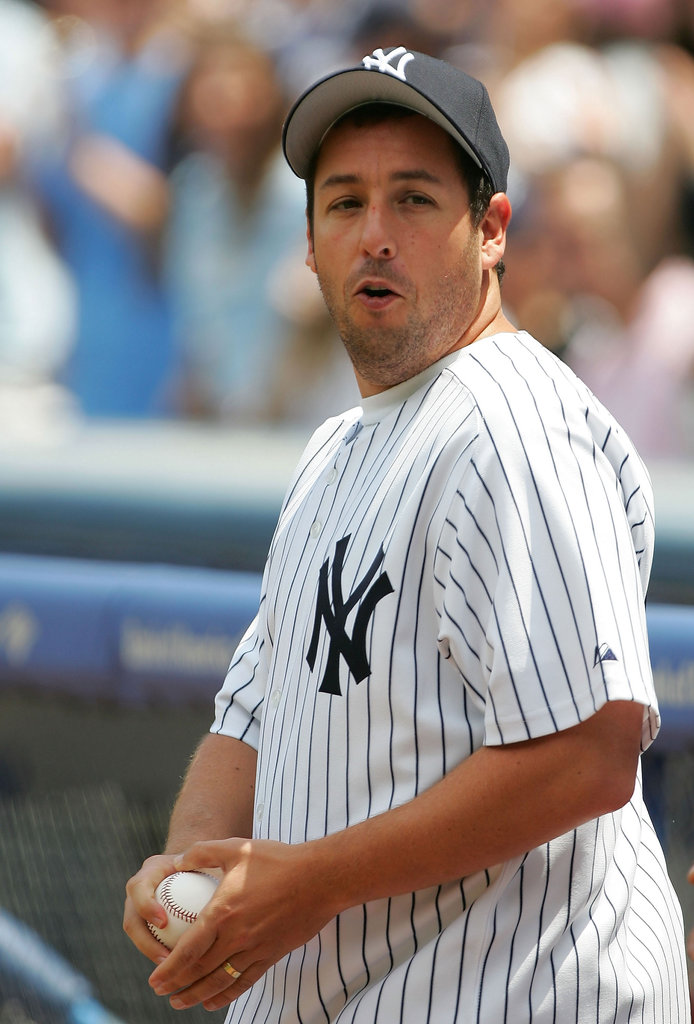 Adam Sandler strapped on his Yankees gear for the first pitch at a game in May 2005.