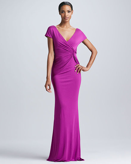 To accentuate curves, try a wrap-and-twist silhouette by Badgley Mischka ($595) in a bright berry shade. It will hug your body, and a bright color is festive and happy.