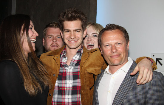 Emma Stone photobombed Andrew Garfield, Eleanor Matsuura, and Neil Stuke at the opening night party for the new play Bull in NYC.