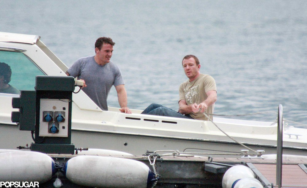 Guy Ritchie and a pal went on a boat ride with George Clooney while at Lake Como in June 2008.