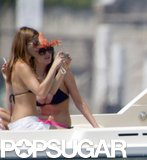 Jennifer Aniston buddied up with Lisa Snowdon to take pictures of their guys at Lake Como back in June 2004.
