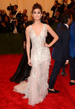 Emmy Rossum brought the drama in a Donna Karan Atelier platinum embroidered lace gown, Irit Design jewelry, and Giuseppe Zanotti heels.