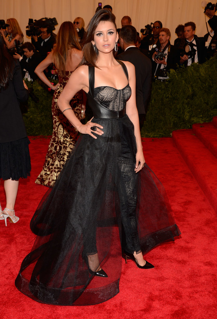 Nina Dobrev made her way up the Met steps.