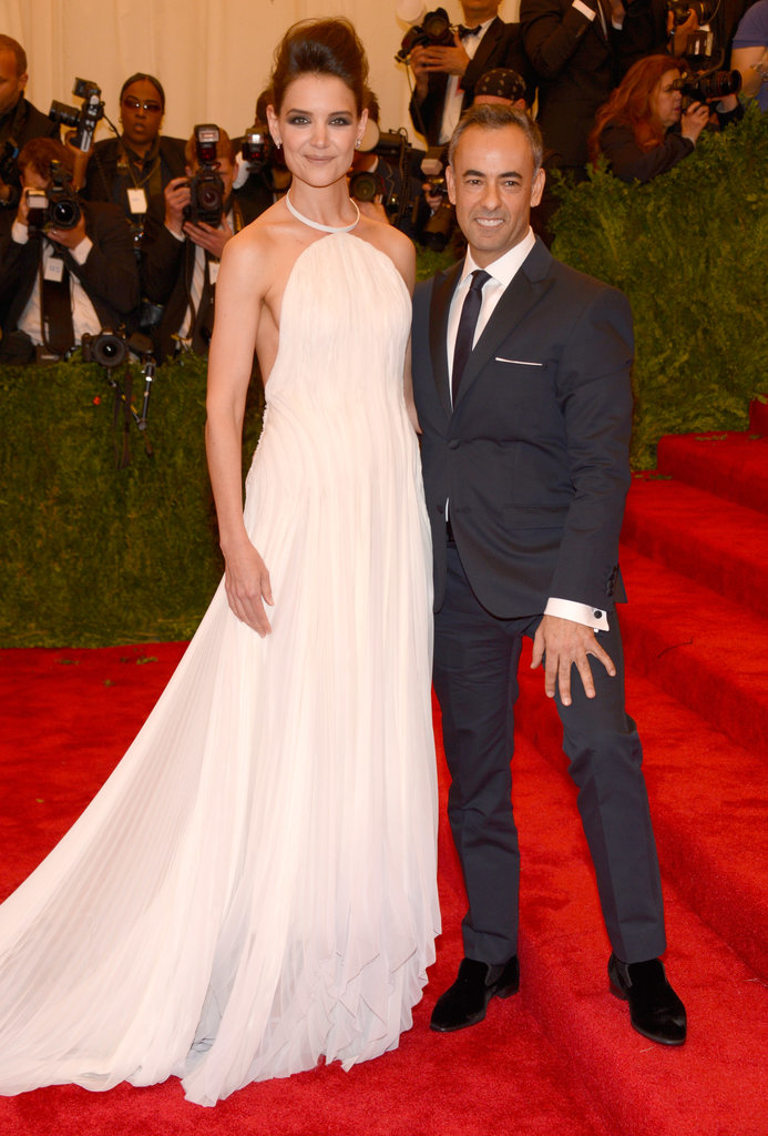 Katie Holmes wore a frothy white halter-style Calvin Klein gown while walking the red carpet on the arm of the brand's designer, Francisco Costa.