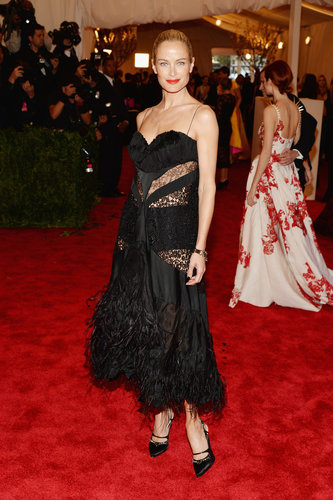 Carolyn Murphy was flirty in a black sheer lace and feather Nina Ricci by Peter Copping midi-length dress.