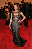 Jessica Alba's laser-cut Tory Burch leather gown featured strategically-placed cutouts.