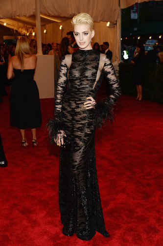 Anne Hathaway went old school in her sheer black, beaded vintage Valentino that set off her new platinum hair.