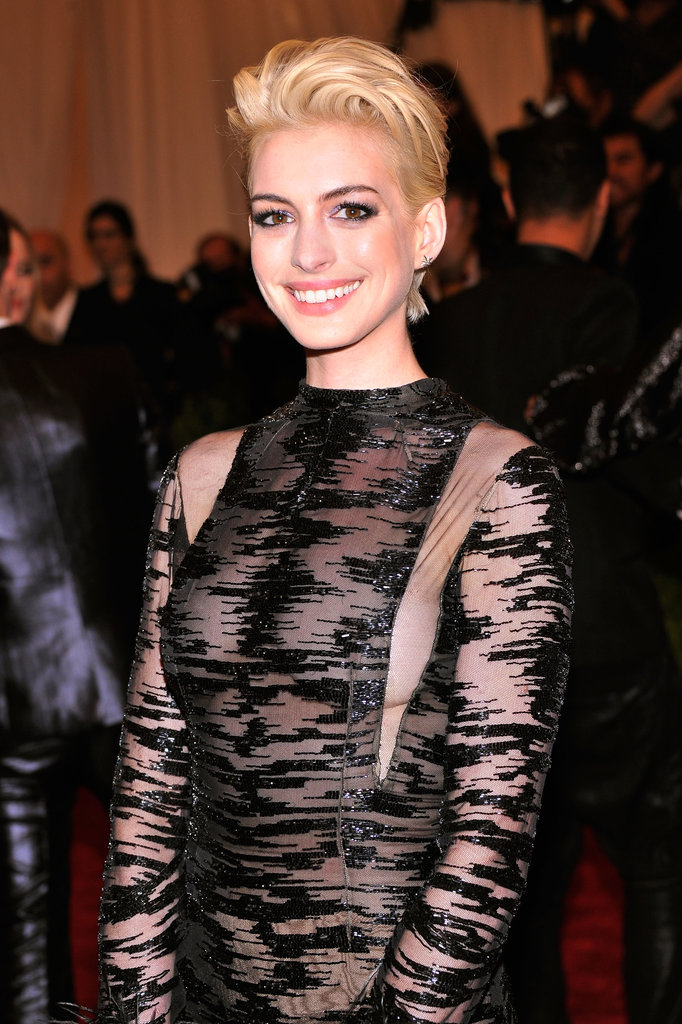 Although she's now back to her natural brunette, Anne Hathaway shocked at this year's Met Gala with a peroxide-blond hair color. The actress said that Debbie Harry inspired her punk transformation for the night.