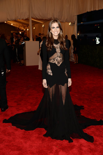 Allison Williams was enveloped in a black sheer lace gown by Altuzarra, Repossi jewels, a Roland Mouret clutch, and Saint Laurent pumps.