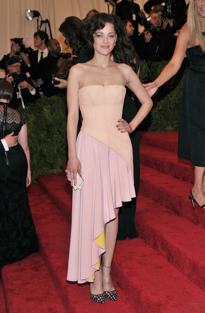 Marion Cotillard stuck to her go-to designer: Christian Dior. She picked a two-tone asymmetrical gown with printed ankle-strap pumps.