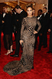 Jennifer Lopez's custom black leopard, sequin-embroidered Michael Kors gown was a lesson in form-fitting tailoring. She added a Christian Louboutin clutch to boot.