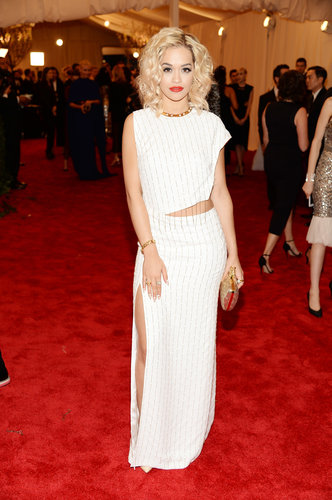 Rita Ora brightened up the red carpet in a fresh white cutout Thakoon gown and Nicholas Kirkwood studded pumps. Her signature gold add-ons and red lips added just enough flair.