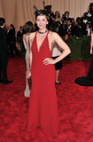 Maggie Gyllenhaal revealed some front and side cleavage in a red halter gown by Calvin Klein.