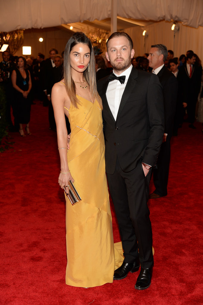 Lily Aldridge wore a minimalist, golden-hued Tommy Hilfiger dress to attend with classically suited husband Caleb Followill.