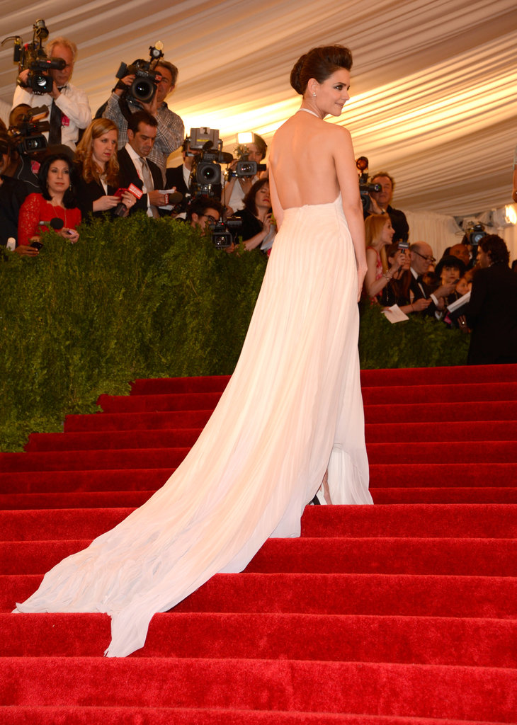 Katie Holmes's Calvin Klein gown got extra train action as she made her way up the stairs.