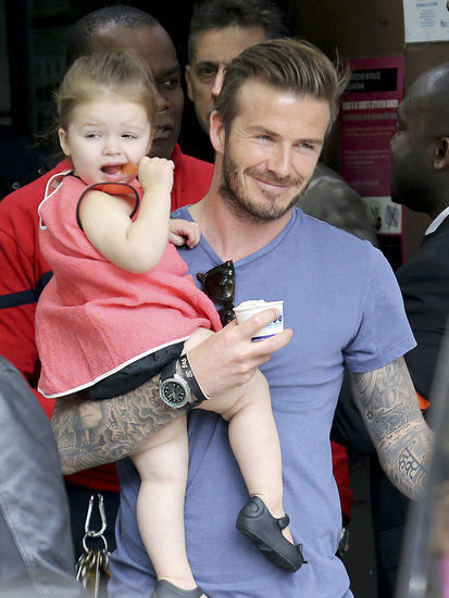 David Beckham held on to his daughter, Harper Beckham, in Paris during a family weekend.