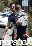 Orlando Bloom carried his son, Flynn Bloom, to a friend's home in LA.