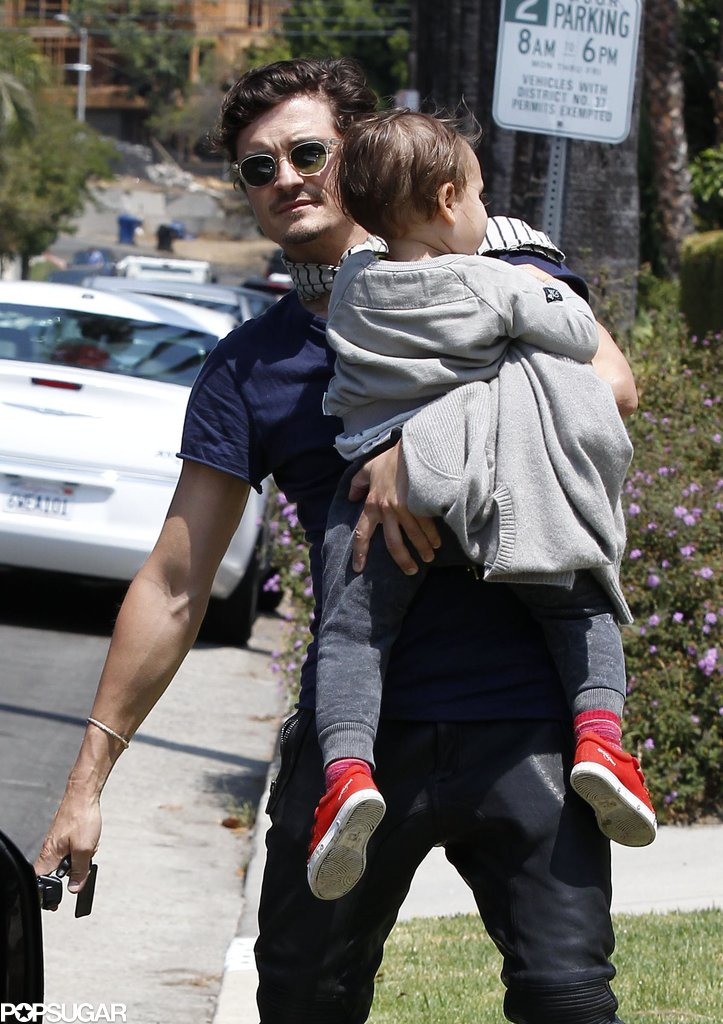 On Saturday, Orlando Bloom carried his son, Flynn Bloom, to a friend's home in LA.