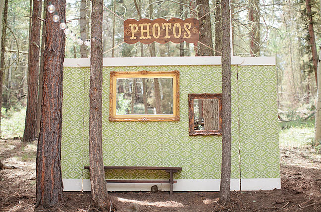 All that's missing from this fun handmade cutout backdrop are some smiling faces.  Photo by Jennefer Wilson via Green Wedding Shoes