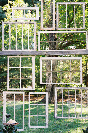 How unique! We love how this backdrop was made from several pieces of wood but gave off the illusion of hanging windows.  Photo by Leah McCormick of Photography by Leah via Style Me Pretty