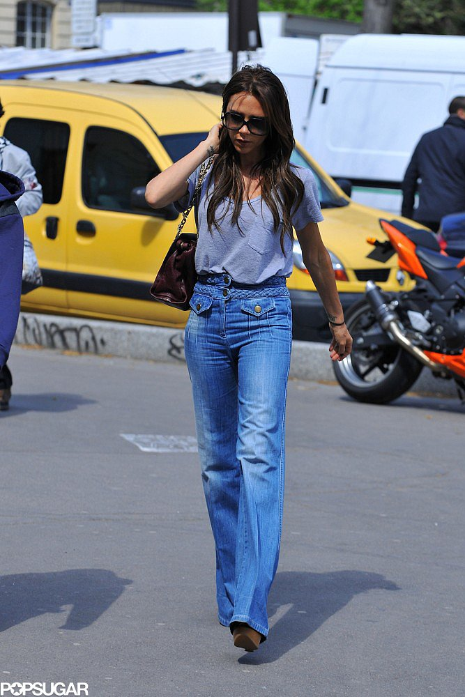 On a previous trip to Paris in April, Victoria sported the exact same ensemble as she did during her May trip. Hey, we're all about repeating flawless looks, too. To get her denim look for less, shop these Free People braided flared jeans ($128).