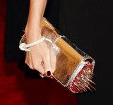 Miranda Kerr carried a Christian Louboutin clutch.