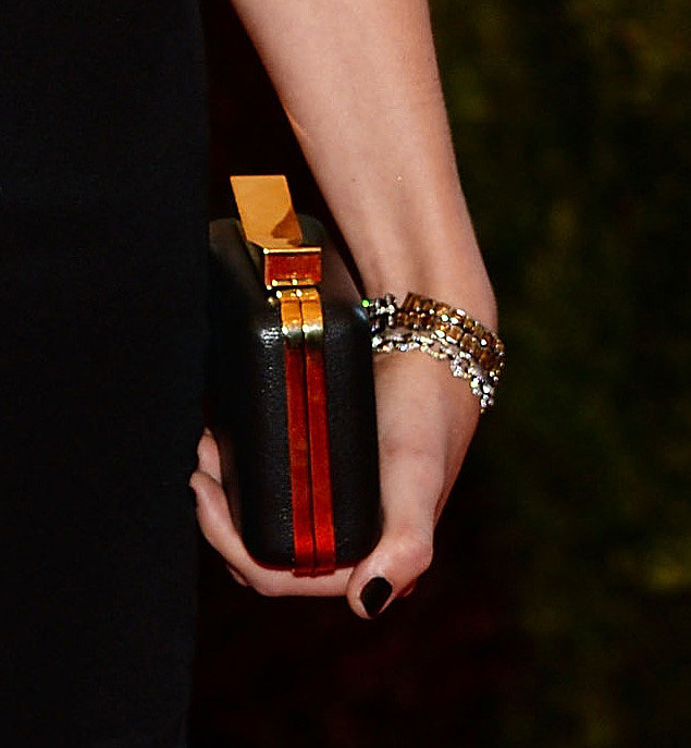 Taylor Swift carried a black-and-gold J. Mendel clutch.