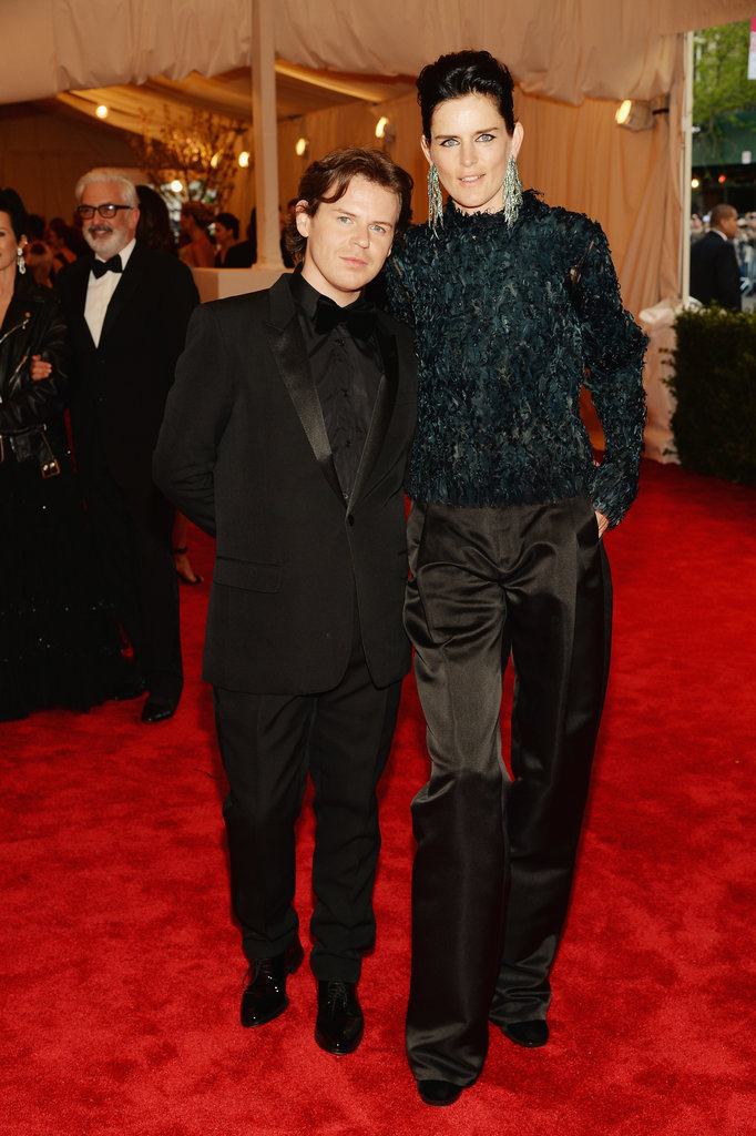 Stella Tennant (with date Christopher Kane), wore some of his very cool tuxedo pants that she paired with a high neck blouse, in black of course!