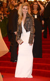 Sienna Miller, who also along with Rita Ora wore a white gown that she topped off with a Burbery studded biker jacket and Burberry box clutch.