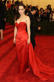 Emilia Clarke dooned a strapless Ralph Lauren gown and Fred Leighton cross earrings.