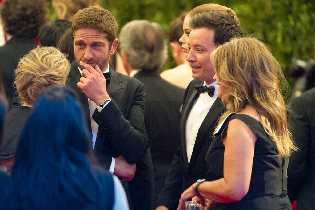 Gerard Butler and Jimmy Fallon chatted with a group on the carpet.