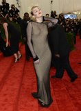 Miley Cyrus's netted Marc Jacobs dress showed that you can still be sexy while staying covered up.