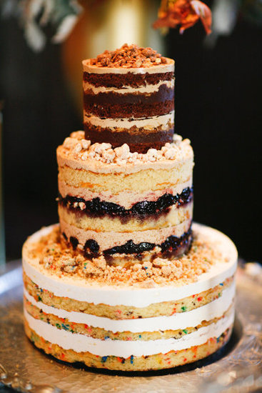 Let's just say that this cake without fondant or frosting is less than traditional (but surely fun!).  Photo by Connie Lyu Photography via Style Me Pretty