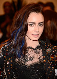 Lily Collins had blue extensions in her hair and amazing looking punked out eye makeup!