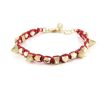 Mix this Ettika red spiked bracelet ($70) with other spiked bangles for a tough-chick arm party.