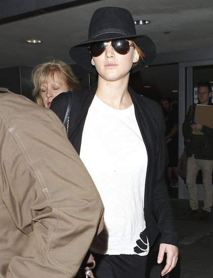 Jennifer Lawrence wore a torn t-shirt when she landed in LA.