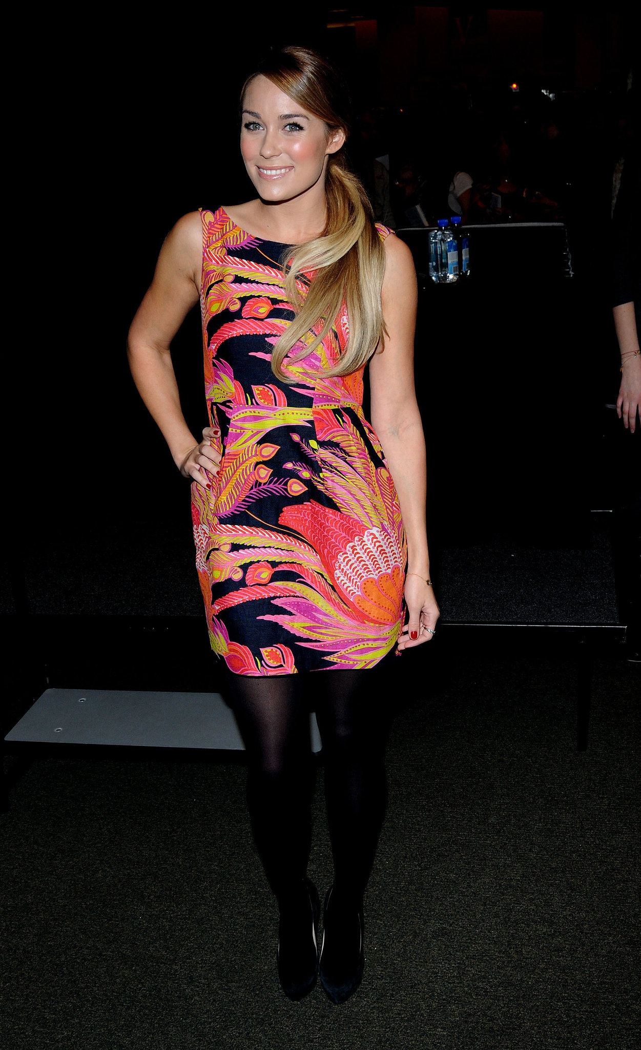 Promoting her book in a psychedelic-print Nanette Lepore dress in 2010. Lesson from Lauren: balance bold prints with streamlined shoes.