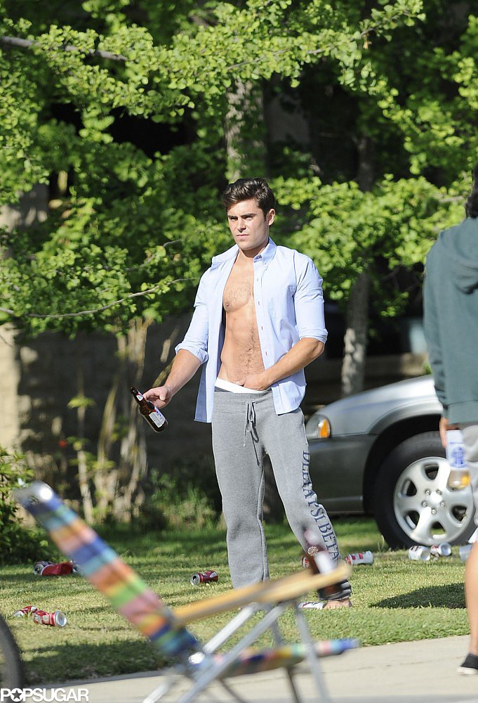 Zac Efron sported an unbuttoned shirt.