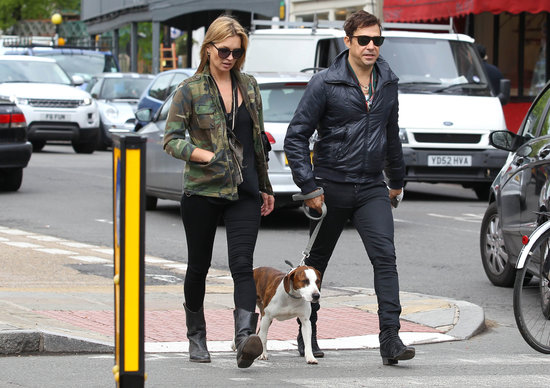 Jamie Hince, Kate Moss, and their dog crossed the street in London.