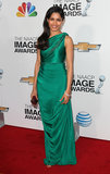 The emerald-green satin one-shoulder gown Indian designer James Ferreira designed for Freida Pinto is undeniably rich and regal for a black-tie ceremony.