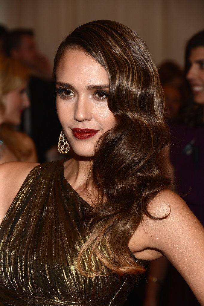 At last year's Met Gala, Jessica Alba's Marcel waves, gilded eye shadow, and moody red lipstick were straight out of the '20s.