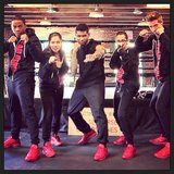 Usher and his team sported matching red kicks while rehearsing for The Voice. Source: Instagram user howuseeit