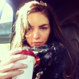 Hilary Rhoda clutched her coffee during an early morning ride to the set. Source: Instagram user hilaryhrhoda