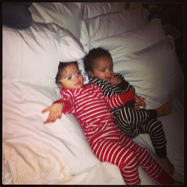 Moroccan and Monroe Cannon snuggled up (in matching PJs!) to watch Shrek in mama Mariah Carey's bed. Source: Instagram user MariahCarey