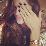 Isabel Goulart showed off a dark manicure and gold rings. Source: Instagram user izabel_goulart