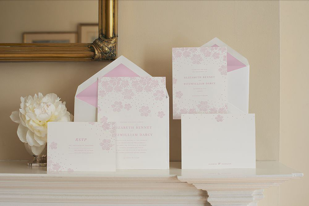 For the soft, feminine wedding, these pink blossoms invitations (prices vary) are perfect. If pink isn't your color, they are also available to be printed in gold and platinum.